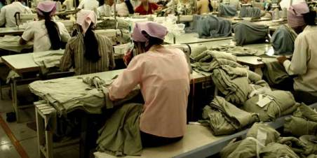 Workers at a garment factory in Southeast Asia. © Jessica Liu.