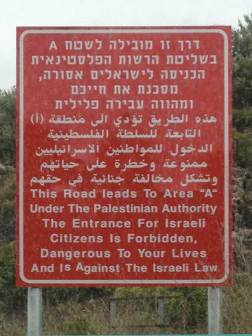 Road sign as you enter Palestine. It is put up by Israel; only Israel enforces it; it keeps Israeli citizens from actually knowing and seeing what is happening.