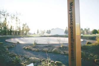 One of the 12 peace poles along the North Valley Friends Trail.