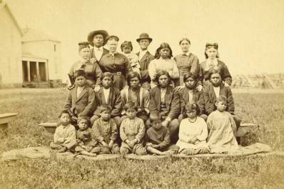 Superintendent Asa C. Tuttle with Quaker teachers and students at Modoc School, Indian Territory, 1877. Courtesy of Quaker Collections, Haverford College.