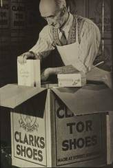 An employee carefully packing Clarks products. Via Wikimedia commons. C&J Clark archive.
