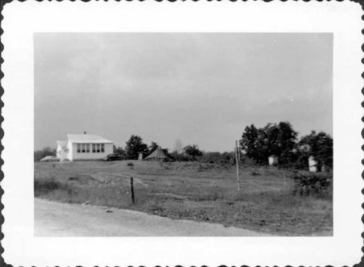 Workcamp site: schoolhouse, tent, outhouses. Ozone, Tenn., 1949