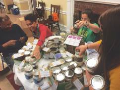 DC STRIDE group members and volunteers create recipe jars as a fundraiser to send campers to camp.