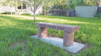 Bench installed beside Shannon's father's grave in the garden of Fort Collins (Colo.) Meeting. Photo courtesy of the author.