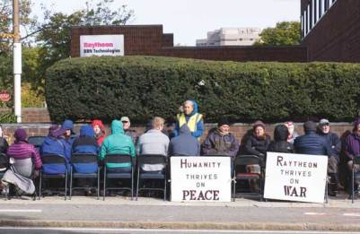 Monthly worship along Fresh Pond Parkway in front of Raytheon in Cambridge, Mass. The author is seen standing. © Skip Schiel.