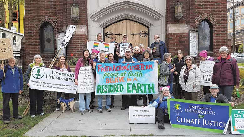 Faith Action Climate Team prepares to march. © Abby Brockway.