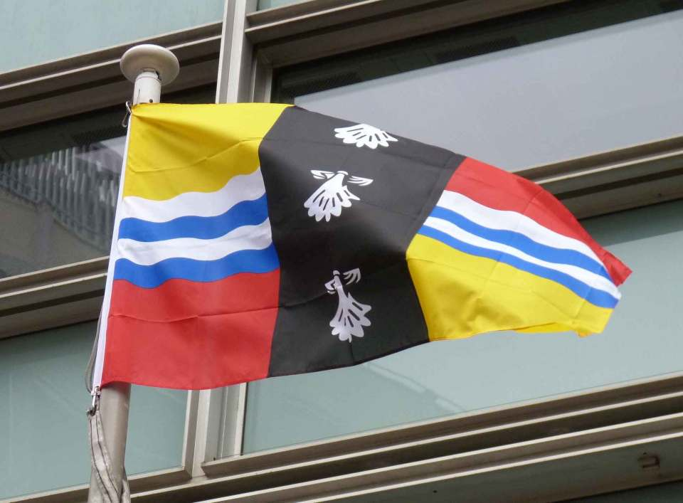 Bedfordshire flag flying outside the the Department for Communities