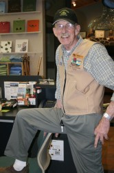 Park volunteer, Wally Carlson, poses at the front desk of the Ice Age Center