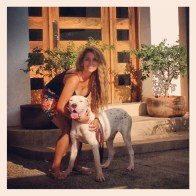 One of our extraordinary volunteers with her foster dog, Donna.