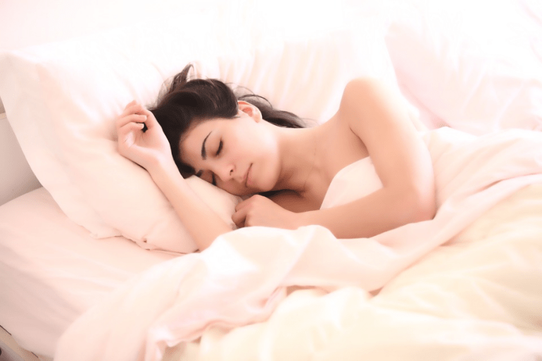 a woman sleeping on the bed