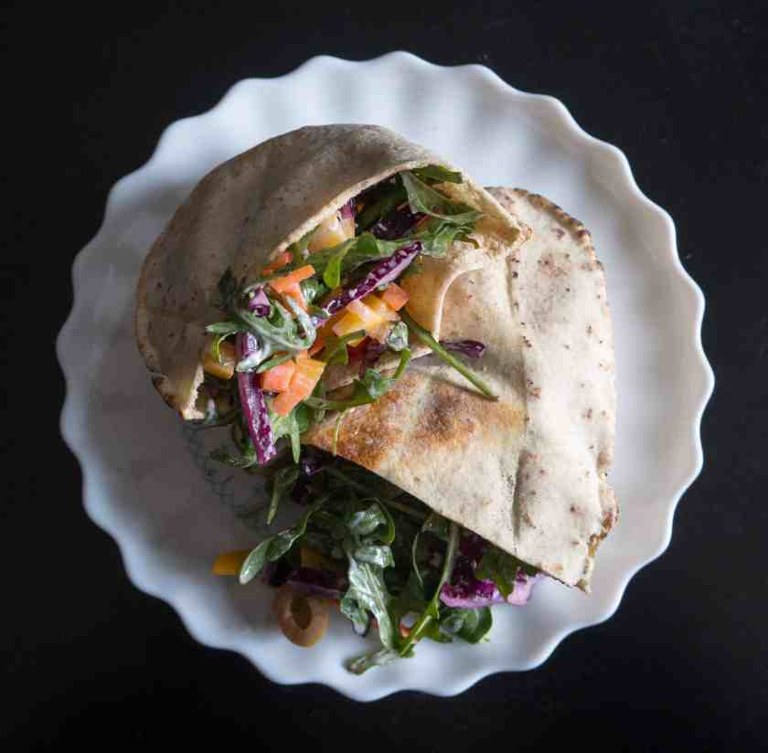 BFee pita stuffed with rocket, carrot, red cabbage, olives and almonds