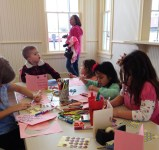 Kids making birthday cards