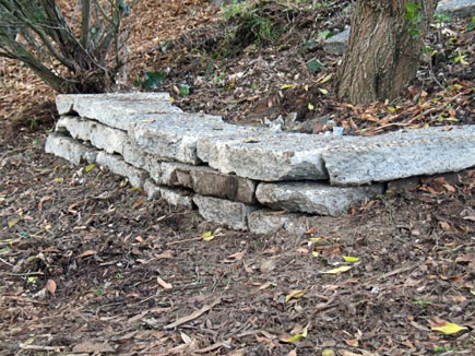 retaining wall made from slabs of broken-up concrete