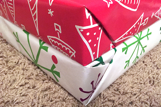 CLoesu-up of the corners of two wrapped gifts.