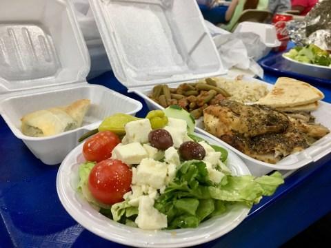 Open platter of Greek food on a tray.