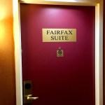 "Photo of a burgundy hotel door that reads, ""FAIRFAX SUITE""."