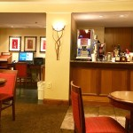 Hotel lounge with business center computer, printer, and bar.