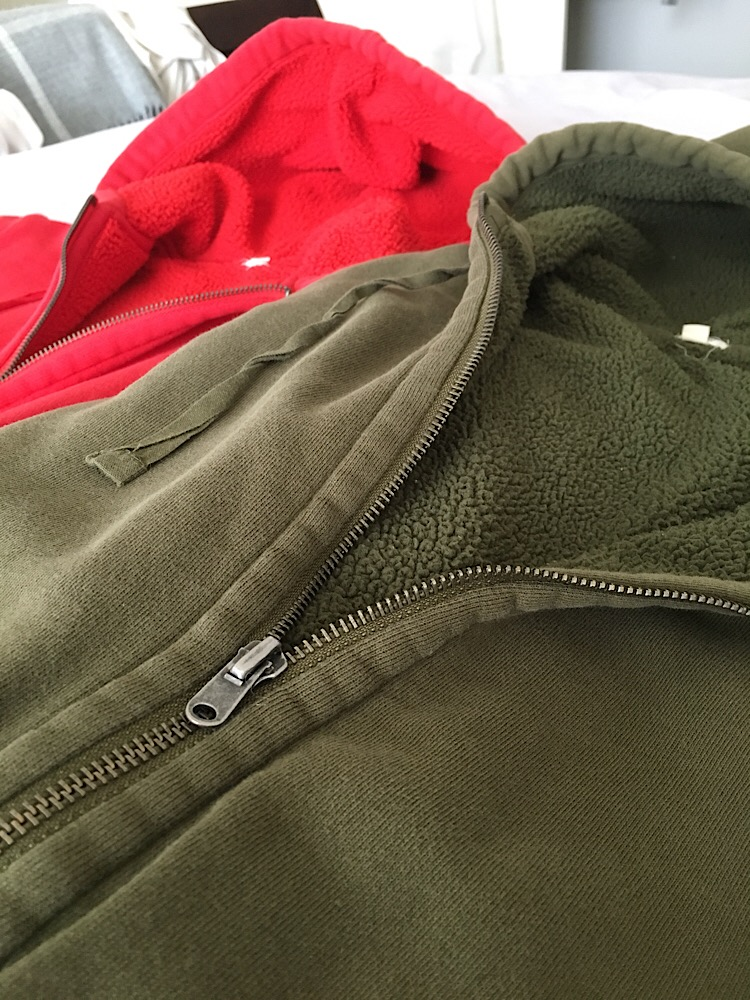 Photo of a drak green sherpa lined hoodie.