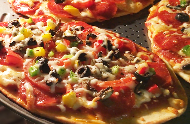Photo of an easy weeknight dinner recipe, naan bread pizzas, cooking in the oven. | Frolic & Courage