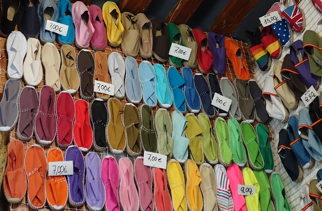 Photo of a wall of colorful espadrilles at Casa Hernanz Alpargatería. Frolic & Courage.