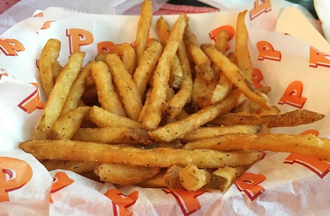 Photo close-up of Popeyes cajun fries.