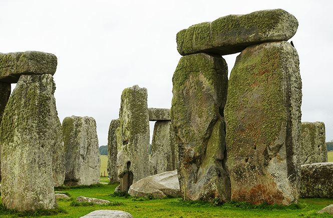 Photo close-up of a few large stones from Stonehenge. Frolic & Courage.