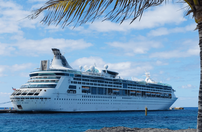 Photo of Royal Caribbean's Enchantment of the Seas cruise ship docked at CocoCay. Frolic & Courage.