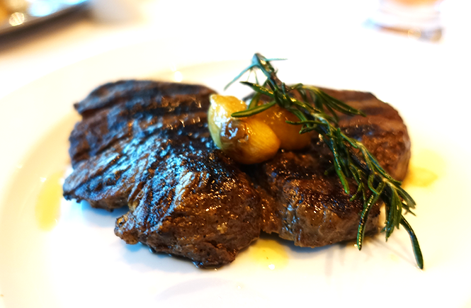 Photo of the 9oz filet mignon from Chops Grille on Royal Caribbean Enchantment of the Seas cruise ship by Frolic & Courage.