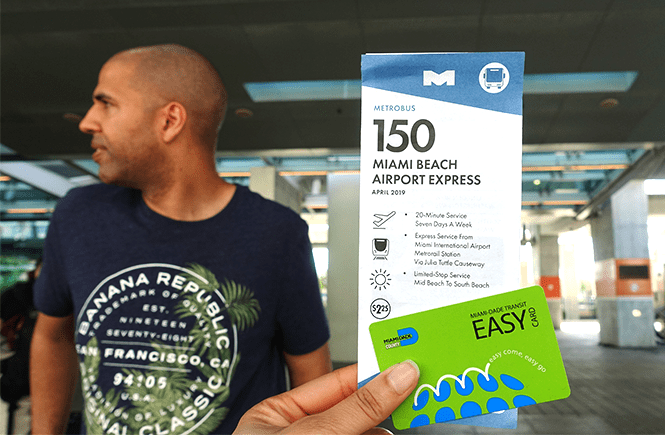 Photo of a Miami Airport Express bus 150 pamphlet, easy card, and my hun at the Miami International Airport bus terminal on the way to South Beach.