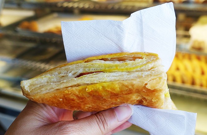 Photo close up my hand holding a pastelito pastry at Yisell Bakery.