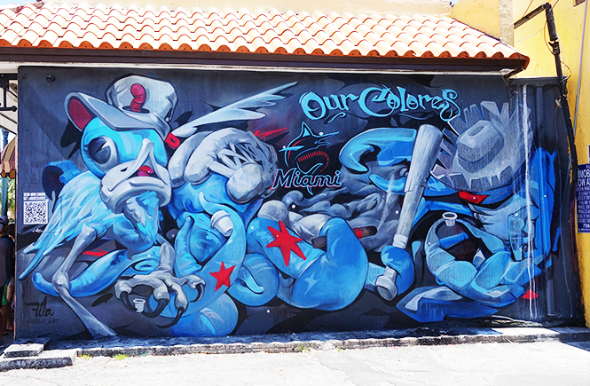 Photo of a blue, red, and whtle Krave Art mural of birds in on honor of the Miami Marlins