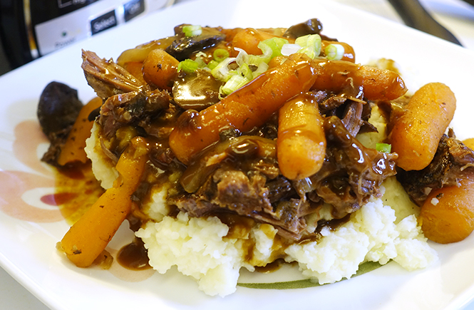 Photo of a plate of pot roast with carrots and mushrooms from my how to make an easy slow cooker pot roast in a crock pot recipe. Frolic & Courage.