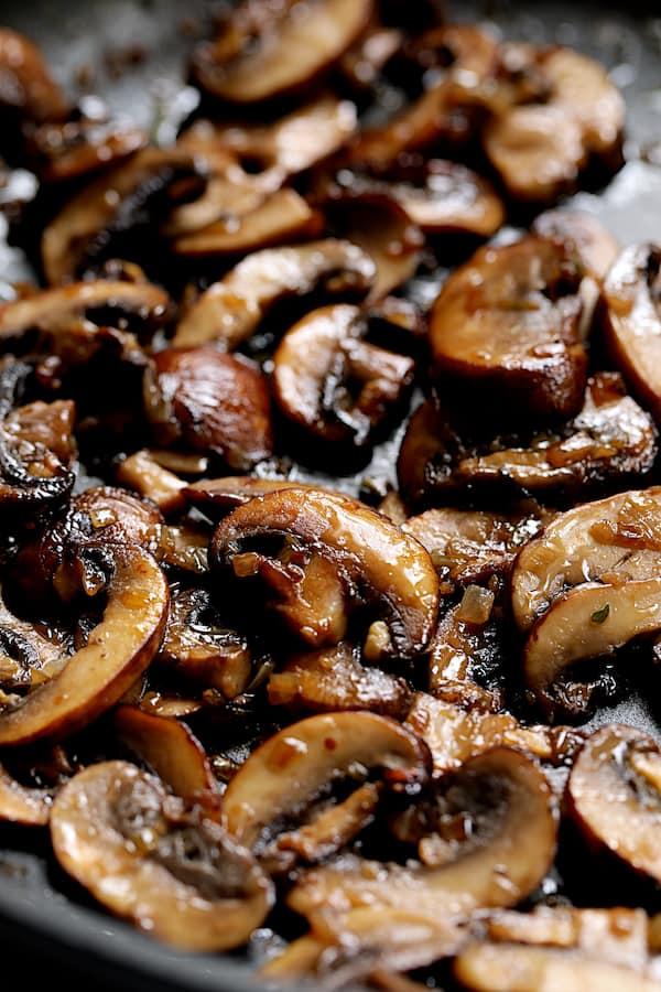 Close-up shot of browned mushrooms in skillet