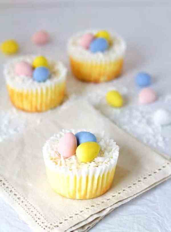 Lighter Mini Cheesecakes - Hero shot of mini cheesecake on small napkin garnished with coconut and malted Easter eggs