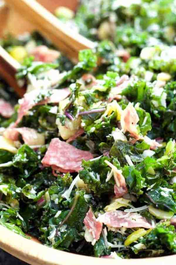 Massaged Kale Antipasto Salad - Close-up shot of salad being tossed with tongs