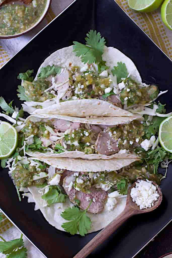 Cumin Lime Roast Pork Tacos with Salsa Verde - Close-up shot on black square plate