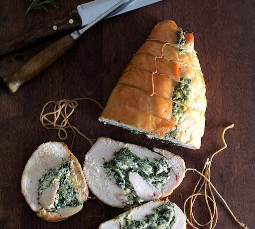 Spinach and Ricotta-Stuffed Turkey Breast with Garlic and Herb Sauce