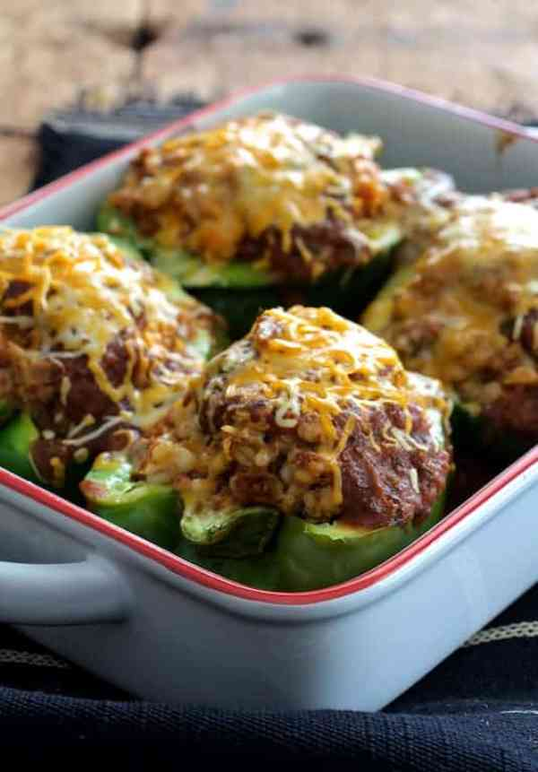 Southwestern Beef and Barley-Stuffed Bell Peppers - Close-up shot of the peppers with the baking dish angled so one is in focus