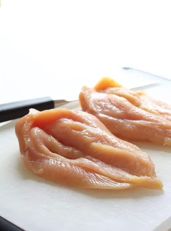 Photo of butterflied chicken breasts on cutting board