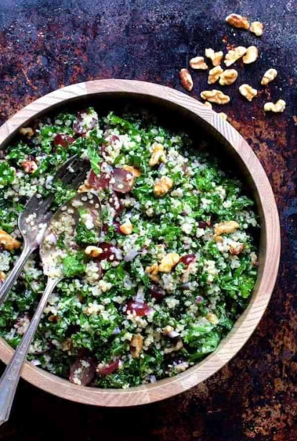 Quinoa and Kale Salad with Red Grapes, Walnuts and Honey - Lemon Dressing - Overhhead shot of salad in wooden bowl