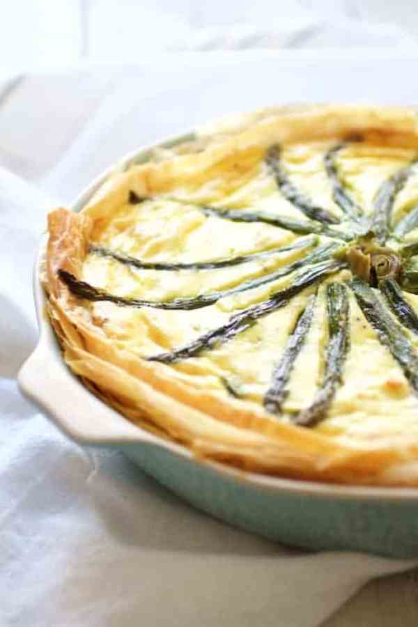 Spring Vegetable Pie with Feta Cheese and Filo Crust - Straight-on close-up shot of pie on white towel