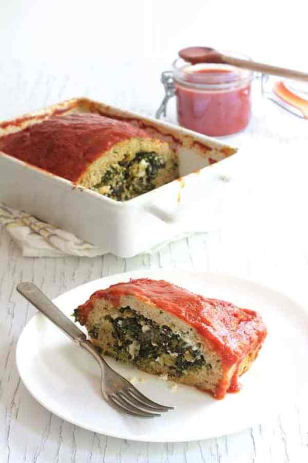 Spinach Feta Stuffed Turkey Meatloaf - Piece of meatloaf on white plate