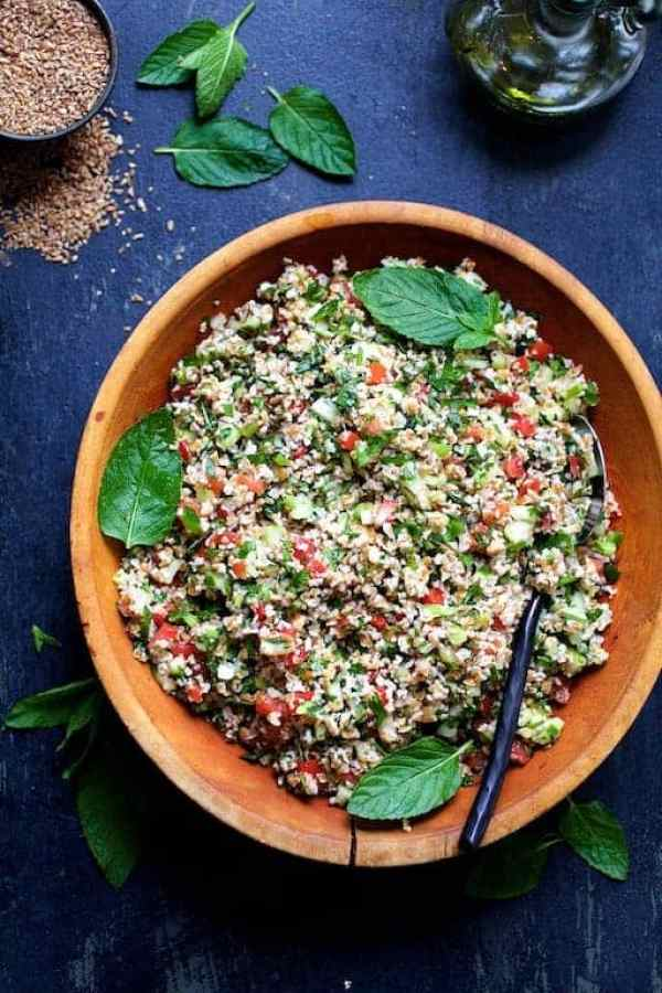 Tabouli with Fresh Jalapeno - Overhead hero shot of salad in wood bowl garnished with fresh mint leaves