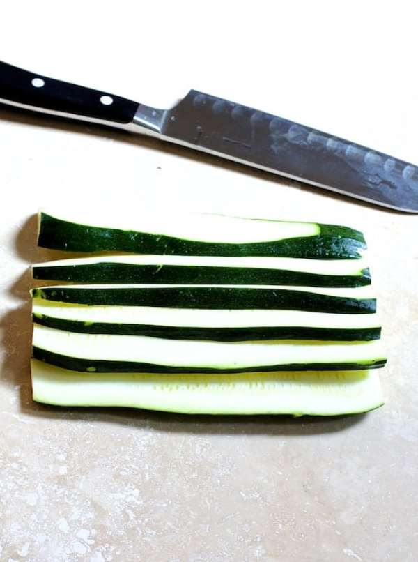 Sliced zucchini with knife