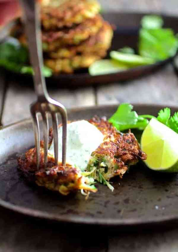 Whole Grain Zucchini Jalapeno Fritters with Cilantro Lime Sour Cream - Fork digging into fritter