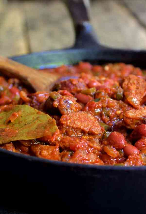 Red Beans and Rice with Chorizo and Bell Pepper Saute - Close-up shot in cast iron skillet