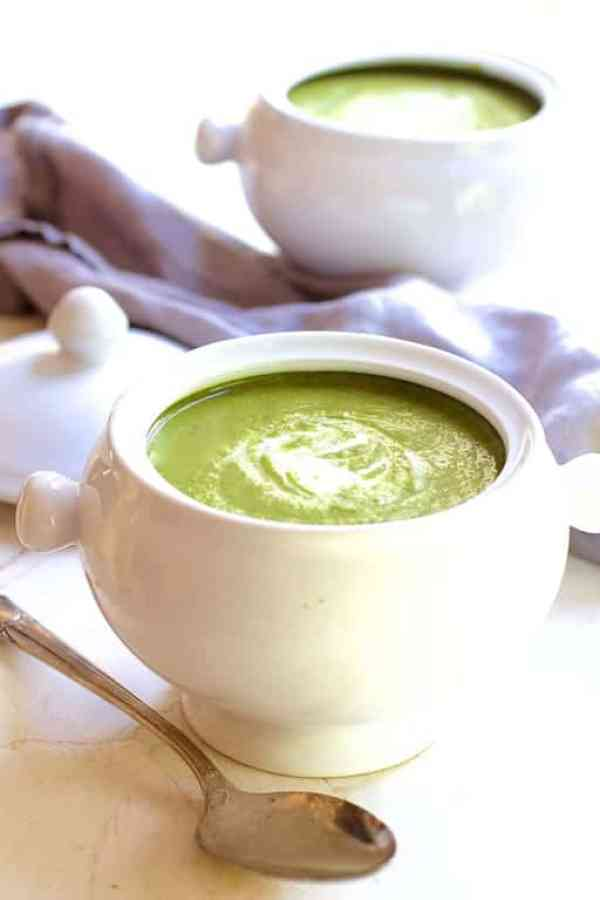 Cream of Green Vegetable Soup in white bowl with spoon on the left side