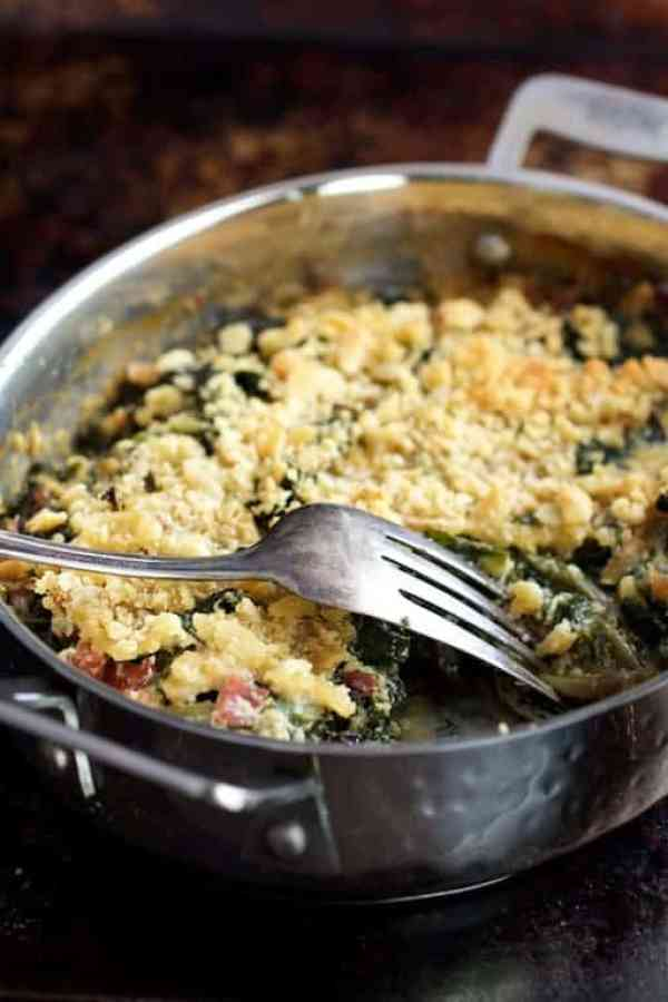 Kale Sprout, Spinach and Arugula Gratin with Cambozola Cheese - Close-up shot of dish with serving fork overturned resting on side of gratin dish