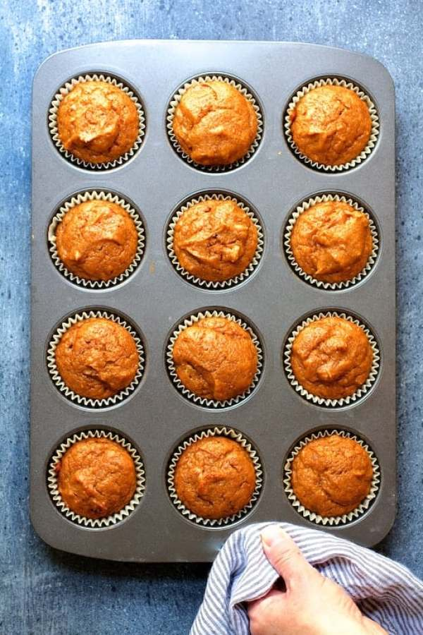 Simply Pumpkin Muffins - Overhead shot of 12 muffins in muffin pan