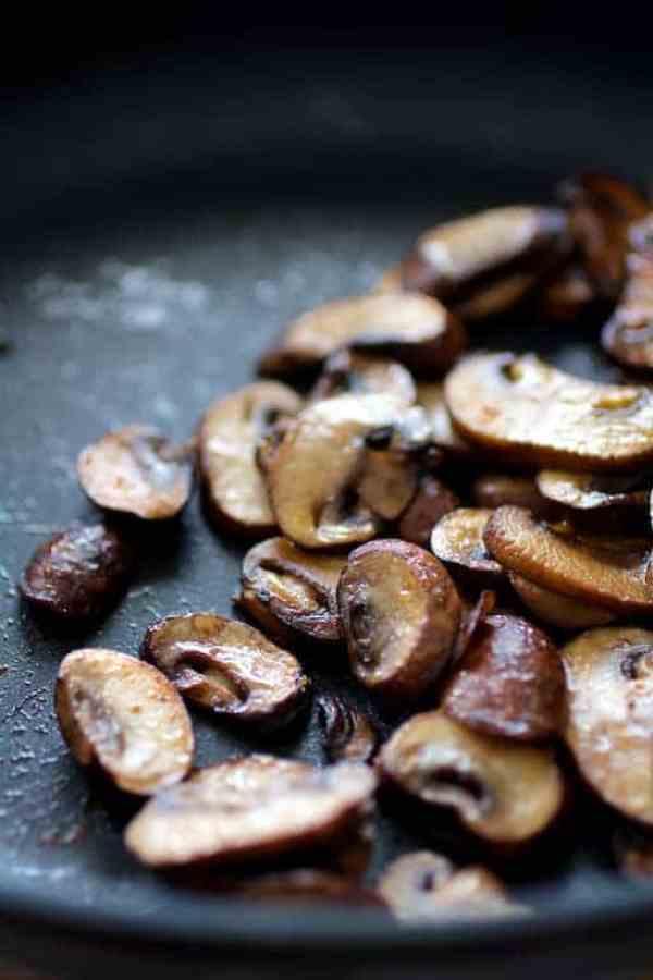 Sauteed cremini mushrooms in skillet